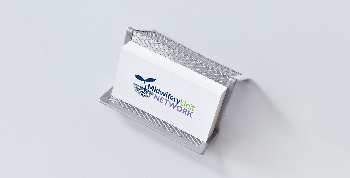 Mock up of a business card with the Midwifery Unit Network logo set on a white background, held in a metal wire stand on a grey background
