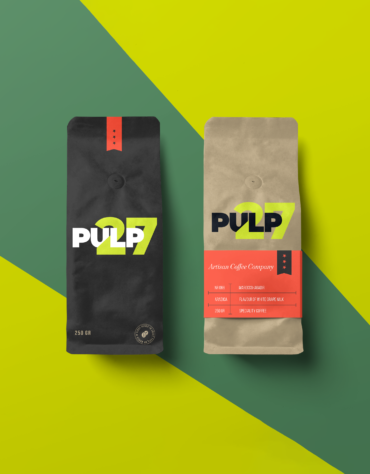 Two coffee bags (one black, one brown)featuring the Pulp 27 branding set on a striped dark green and light green background.